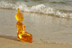 Buddha on a beach Royalty Free Stock Image
