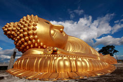 Buddha. Beautiful gold buddha with blue sky background Stock Photo