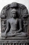 Buddha in Bhumisparsha. From 10 -11th century found in Bihar now exposed in the Indian Museum in Kolkata, West Bengal, India royalty free stock photo