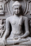 Buddha in Bhumisparsha. From 10 -11th century found in Bihar now exposed in the Indian Museum in Kolkata, West Bengal, India royalty free stock photography