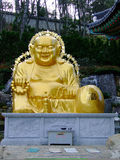 Buddha. Big Buddha sits in the hand holds a rosary at the foot of the e-mails Stock Images