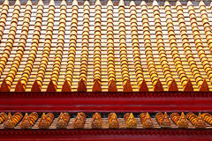 Buddha-Bild auf Tempeldachfliesen Stockfotografie