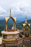 Buddha-Bild an der Seite der Pagode Lizenzfreie Stockbilder