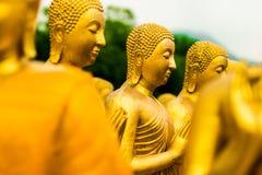 Buddha-Bild von Lord Buddha unter den 1.250 Mönchen Stockfotografie