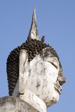 Buddha and the Bird. A mynah bird rests on the top of an ancient Buddha statue in the ancient Siamese city of Sukothai stock images