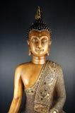 Buddha Black 1. Sitting Buddha on dark backgroundd Royalty Free Stock Images