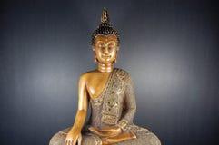 Buddha black 3. Sitting Buddha statue on dark background Royalty Free Stock Image