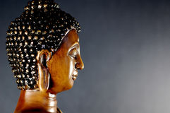 Buddha black 4. Buddha statue side view head shot Royalty Free Stock Images