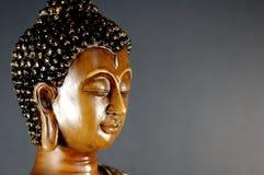 Buddha black 6. Buddha on dark background off-centered to the left head shot Stock Image