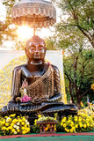 Buddha black statue in Sanam Luang, Bangkok, Thailand. Buddha black statue in the bright rays of the sun, Sanam Luang, Bangkok, Thailand Stock Photos