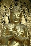 Buddha Blesses. Bronze icon blessing Buddha in serene mood Stock Photography
