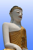 Buddha with blue background. Buddha statue with a blue background stock photography