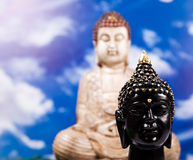 Buddha and blue sky background, vivid colors, natural tone Stock Image