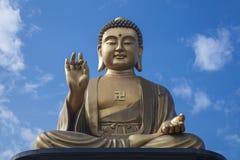 Buddha and blue sky Stock Photo