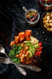 Buddha bowl, the concept of healthy diet, black background, top view. Buddha bowl of mixed vegetables, healthy and nutritious vegan meal Stock Image