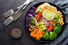 Buddha bowl dish with chicken fillet, brown rice, avocado, pepper, tomato, broccoli, red cabbage, chickpea, fresh lettuce salad, p. Ine nuts and walnuts. Healthy Stock Photo