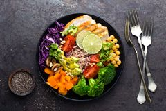 Buddha bowl dish with chicken fillet, brown rice, avocado, pepper, tomato, broccoli, red cabbage, chickpea, fresh lettuce salad, p. Ine nuts and walnuts. Healthy Stock Images