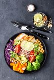 Buddha bowl dish with chicken fillet, brown rice, avocado, pepper, tomato, broccoli, red cabbage, chickpea, fresh lettuce salad, p. Ine nuts and walnuts. Healthy Royalty Free Stock Photography