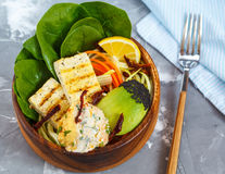 Buddha bowl with grilled tofu, hummus and vegetables. Stock Photo