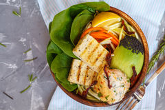 Buddha bowl with grilled tofu, hummus and vegetables. Stock Photos