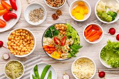 Buddha bowl, healthy and balanced vegan meal, fresh salad with a variety of vegetables, healthy eating concept. Top view stock images