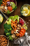 Buddha bowl, healthy and balanced vegan meal. Buddha bowl of mixed vegetables, healthy and nutritious vegan meal, top view Royalty Free Stock Photography