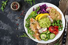 Buddha bowl lunch with grilled chicken and quinoa, tomato, guacamole Royalty Free Stock Images
