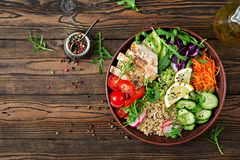 Buddha bowl lunch with grilled chicken and quinoa, tomato, guacamole Stock Photos