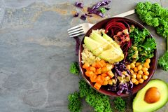 Healthy eating Buddha bowl on dark background. Top view, side border with copy space. stock images