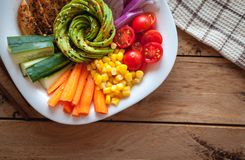 Buddha bowl with roasted chicken and fresh vegetables on wooden background, top view stock images