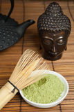 Buddha bronze with green tea Stock Photo
