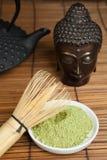 Buddha bronze with green tea Stock Photo