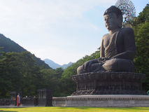 Buddha bronze statue and monk, Sinheungsa temple, South Korea Stock Photos