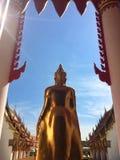 Buddha of Buddhist devotion. Gold Buddha of Buddhist devotion blue background royalty free stock photo