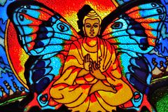 The buddha-butterfly. Painting on glass , own artwork Royalty Free Stock Photography