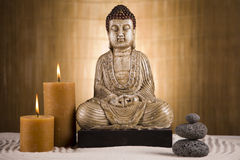 Buddha and candle closeup Stock Image