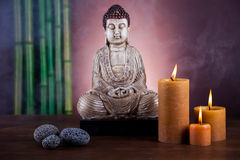 Buddha with candle, vivid colors, natural tone Stock Photography