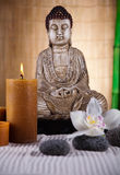 Buddha with candle, vivid colors, natural tone Royalty Free Stock Photography
