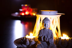 Buddha with candles royalty free stock photo