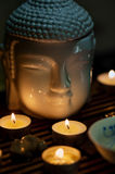 Buddha and candles, Chinese tea ceremony Stock Photos