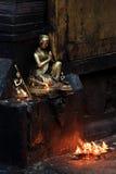 Buddha with candles in the Swayambhunath Stupa, Kathmandu, Buddh Royalty Free Stock Photo