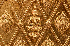 Buddha carved gold wall Royalty Free Stock Photo