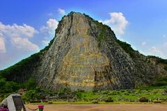 Buddha carved on the mountain. stock photo