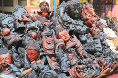 Street market handicraft shopping New Delhi India. Buddha carving handicraft shop at Paharganj Main Bazaar market in New Delhi India stock photography