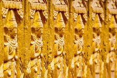 Buddha carving Thailand. Buddha carving yellow on wall at temple Thailand royalty free stock images