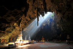 Buddha in a cave royalty free stock photography