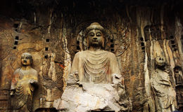 The Buddha caves of China. Longmen Grottoes is one of the Chinese stone carving art treasure house and it is one of China's four major grottoes Royalty Free Stock Photos