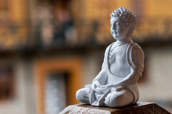Buddha ceramic statue.  Yoga, buddhism, meditation background with empty space for text Stock Image