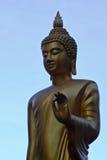 Buddha China Gold on a blue background. Gold Buddha Statue on blue sky background Royalty Free Stock Photo