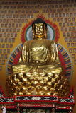 Buddha, China. Photo of Buddha statue with thousand buddha in the wall taken in China Stock Image